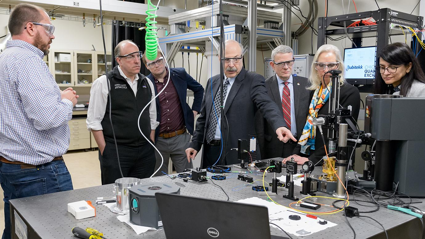 University of Chicago and Argonne scientist David Awschalom (center) discusses quantum entanglement with Department of Energy Under Secretary for Science Paul Dabbar (second from the left) and other laboratory, DOE and University leaders and researchers.